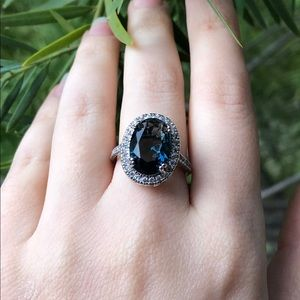 Natural Oval Blue Topaz Sterling Silver Ring
